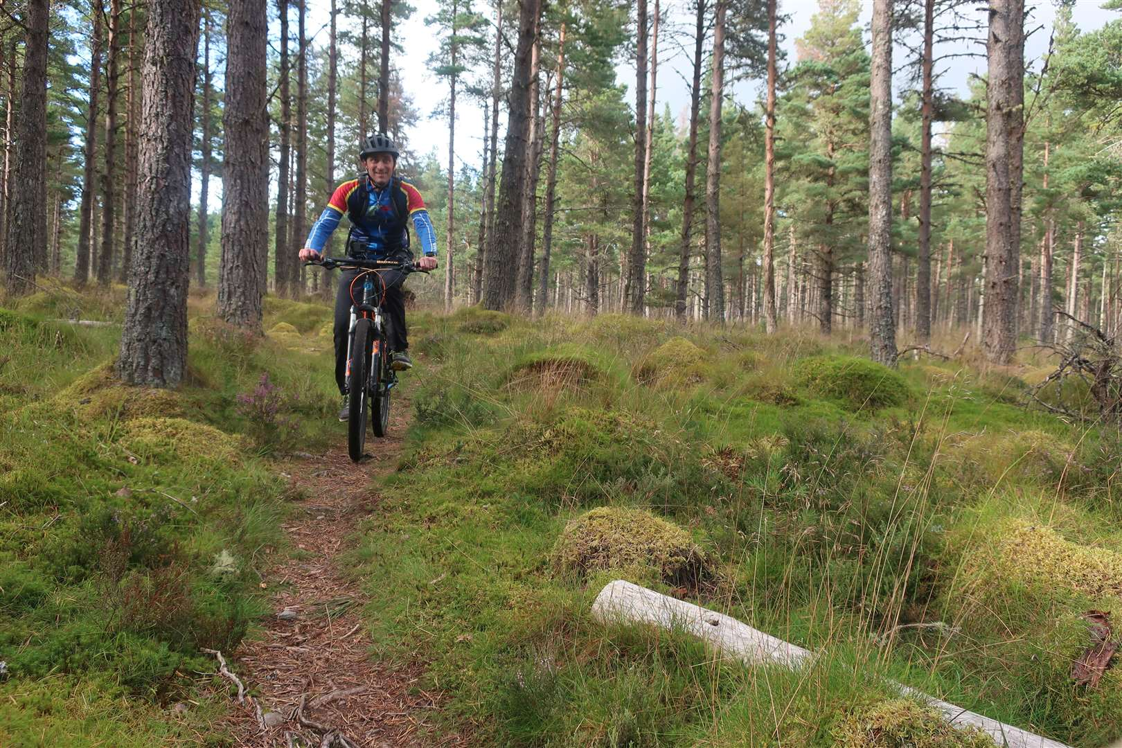 John enjoying the beautiful singletrack which was an unexpected find on this route.
