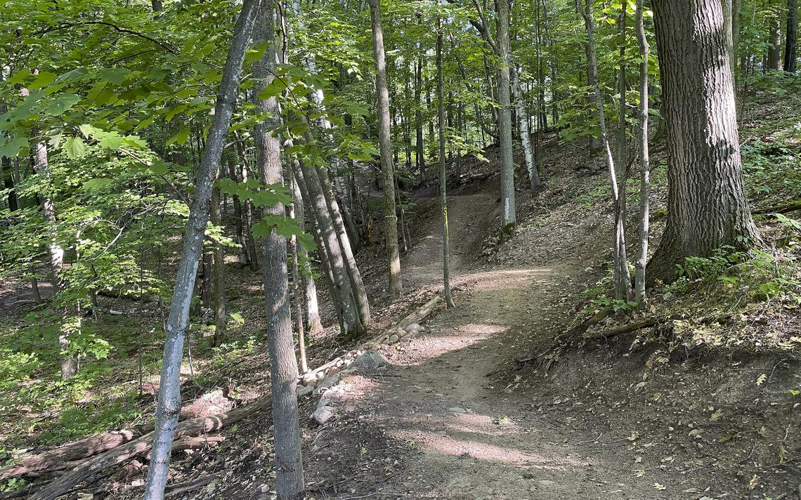 The landscape of the rolling glacial terrain on the Cruser's Kettle mountain bike trail by Cuyuna is 100% natural. Photo by Aaron Hautala